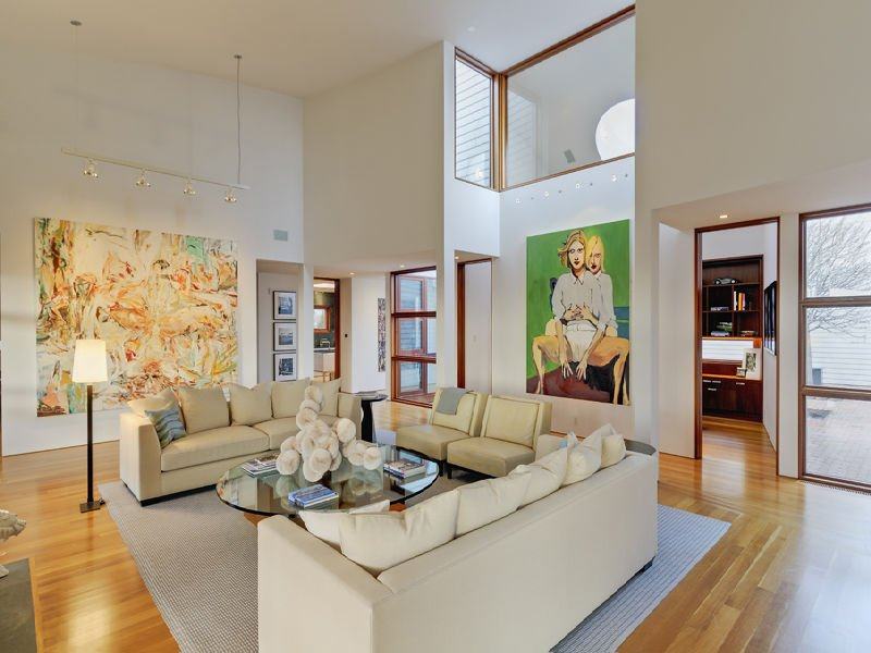 the-home-has-high-ceilings-and-lets-in-a-lot-of-light
